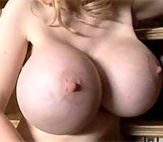 Alena plays with her huge tits