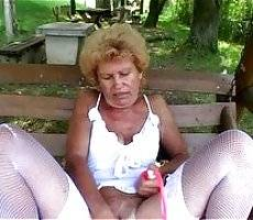 Francesca was hanging out by the park waiting for some hot hunk to pass her and fuck her hard. She was already dressed in sexy stockings but still no one came. So Francesca decided that it is best to plow her cunt with a very big dildo right there on