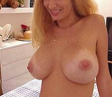 Busty amateur sucks on the nutsack