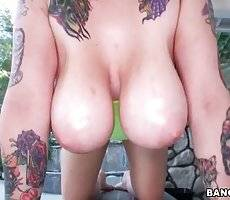 Tattooed Chick Shows Her Big Ass And Juggs 1